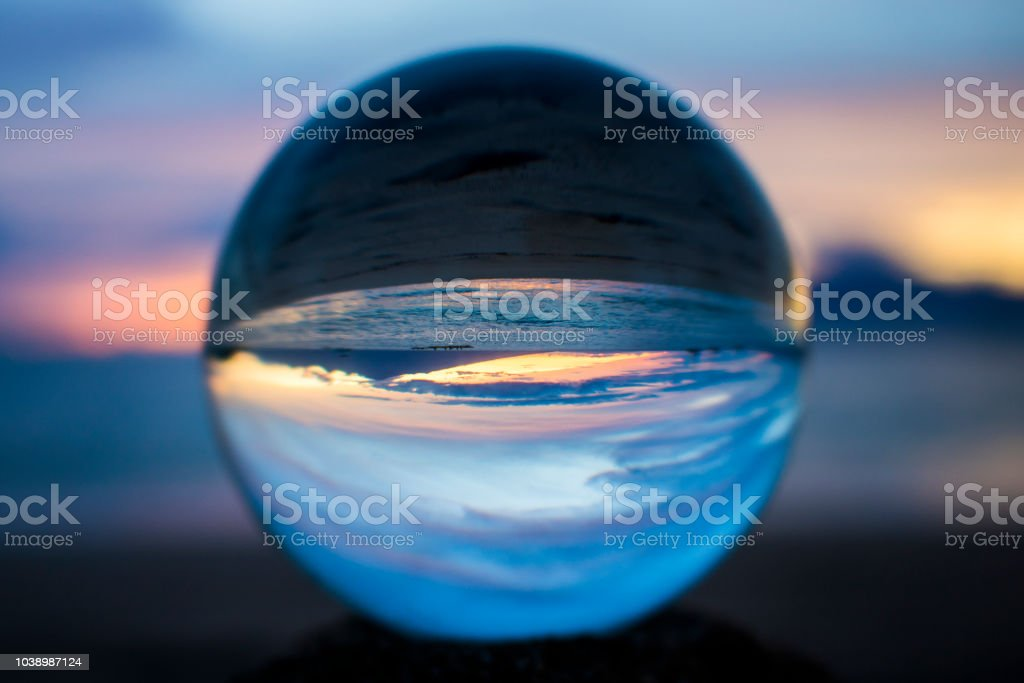 Orange Sunset Captured in Ball with Sea and Sky stock photo