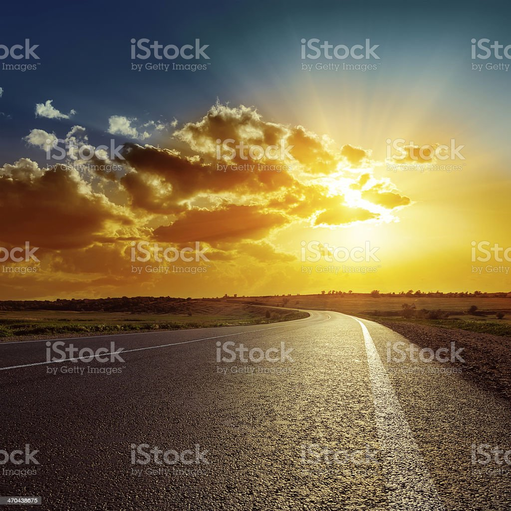 orange sunset over asphalt road stock photo
