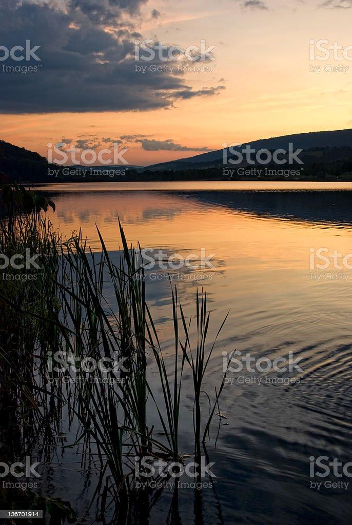 Orange Sunset Over Lake with Mountain Background royalty-free stock photo
