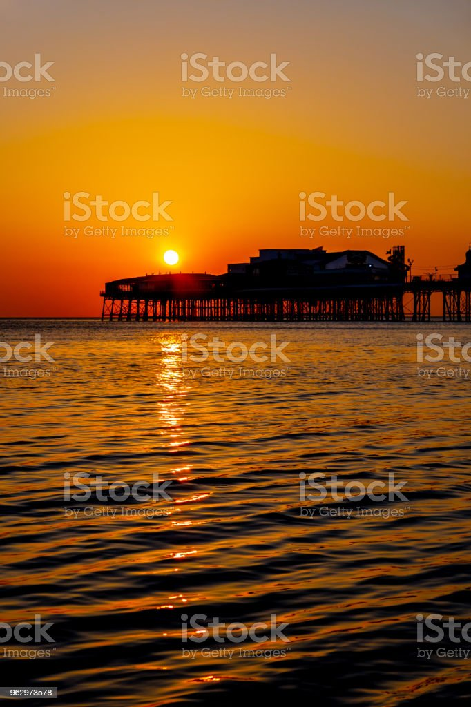Orange sunset over the pier in Blackpool, Lancashire stock photo