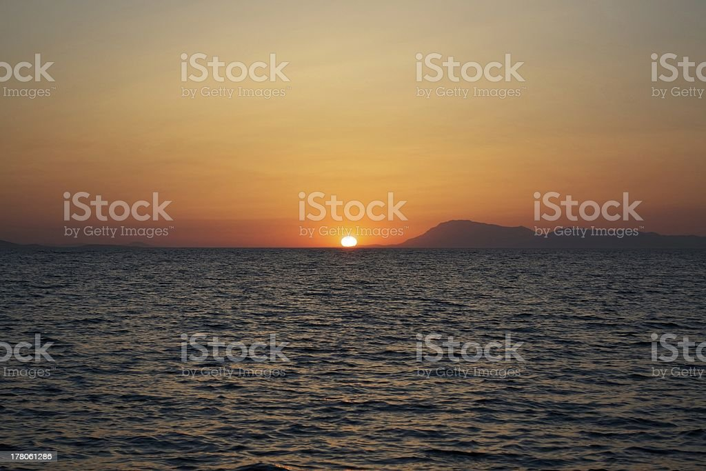 Orange sunset over turkish waters stock photo