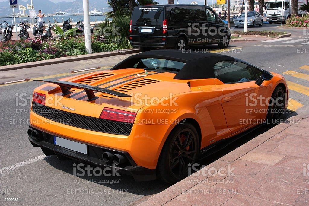Orange Supercar Lamborghini Gallardo Spyder At The City Street Stock