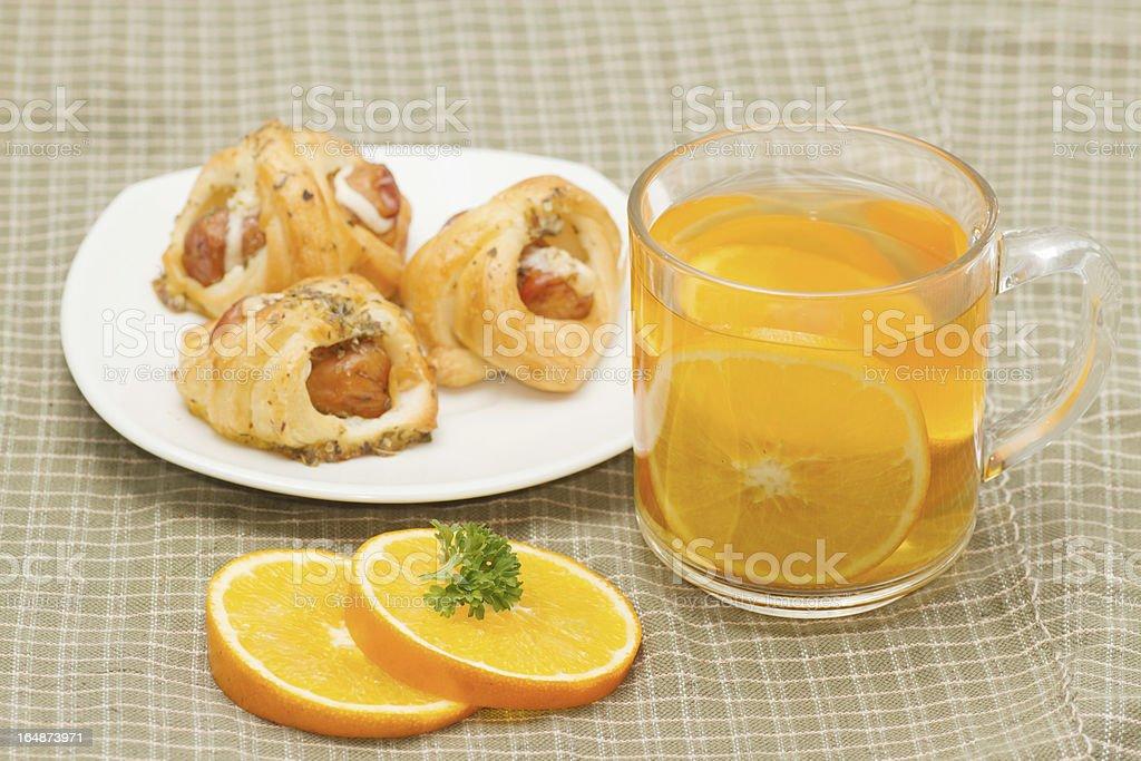orange tea with little  croissant royalty-free stock photo