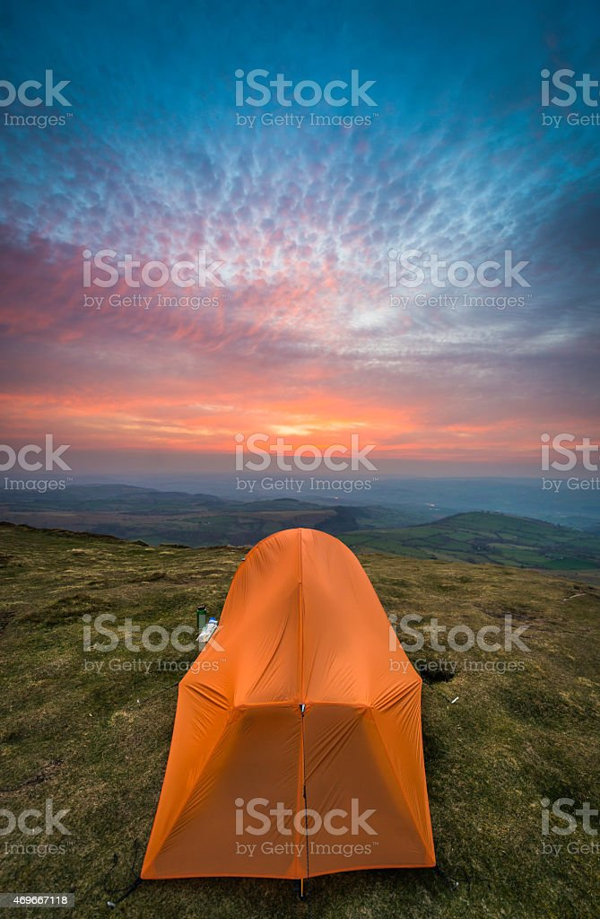 Orange tent on mountain wild c& big sky sunset Wales royalty-free stock photo & Orange Tent On Mountain Wild Camp Big Sky Sunset Wales stock photo ...