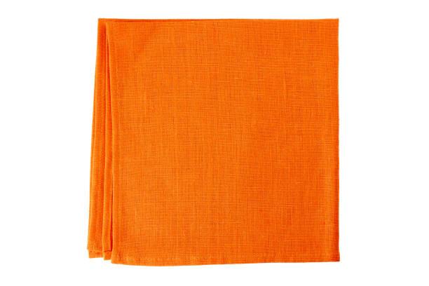 Orange textile napkin on white stock photo