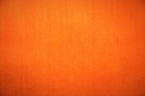 orange textil samt stoff flauschig hintergrund in leuchtenden farben - rostrot stock-fotos und bilder