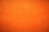istock Orange textile velvet fabric fluffy background in bright soft colors 960340714