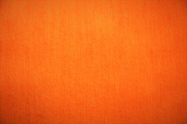 orange textile velvet fabric fluffy background in bright soft colors - corduroy stock pictures, royalty-free photos & images