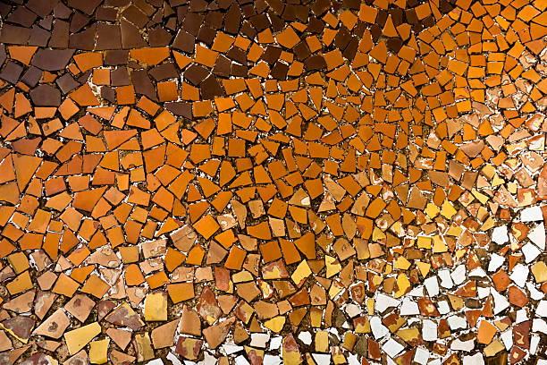 Orange Tones Ceramic Mosaic by Gaudì, Barcelona Orange ceramic mosaic at the Casa Batllo in Barcelona, Spain. The house was designed and built by the spanish architect Antoni Gaudi in 1904-1907. casa batllo stock pictures, royalty-free photos & images