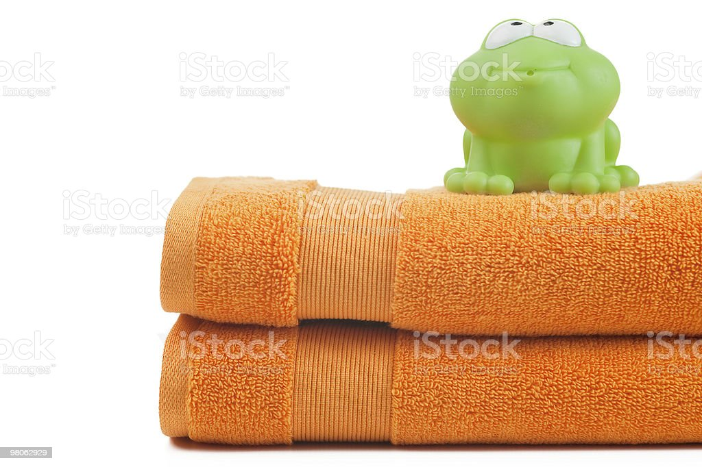 orange towels and toy frog royalty-free stock photo