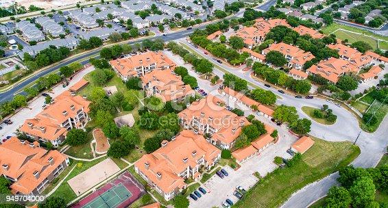 176823773 istock photo Orange townhomes aerial drone view high above suburb suburbia apartment new development 949704000