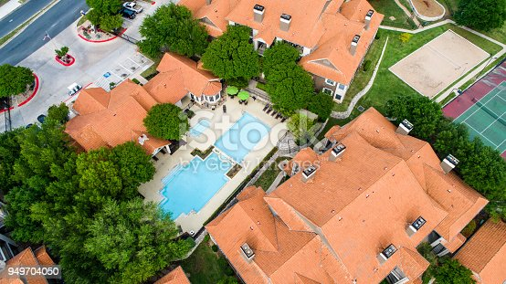 176823773 istock photo Orange townhomes right above rooftop of Townhome Apartment Complex 949704050