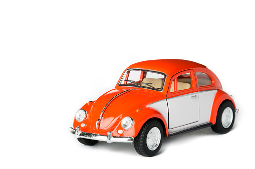 Ski, Norway - January 28, 2016: An orange VW toy car. Also known as beetle.