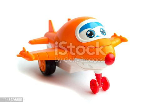 912120622 istock photo orange toy plane. children's toy. plastic toy 1143526856