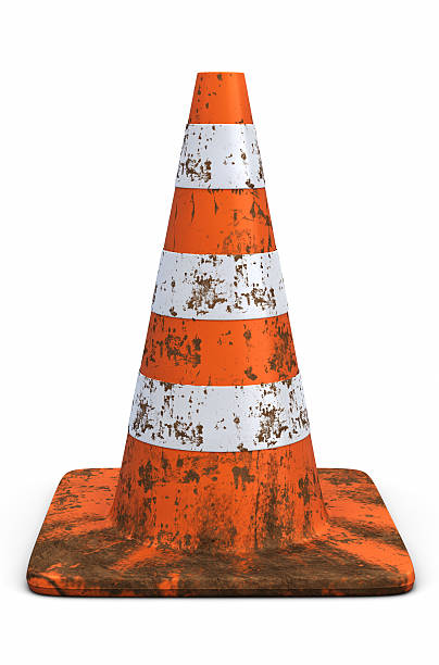 Orange Traffic Cone Covered in Dirt stock photo