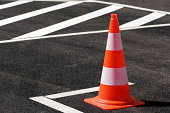 Traffic cone /pylon on a brand-new parking place.