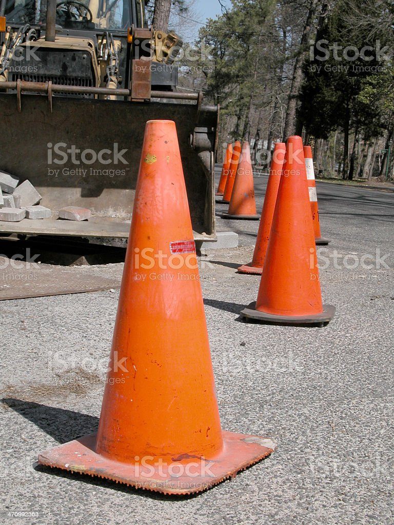 Orange Traffic Cones and Front Loader Bulldozer royalty-free stock photo