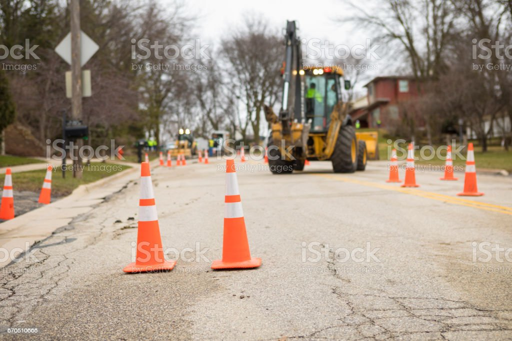 Orange Traffic Safety Cones at a Residential Street Repair Project stock photo