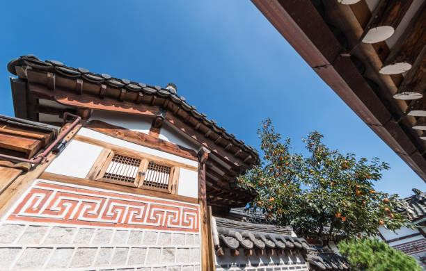 Orange tree and roofs of Bukchon Hanok Village in Seoul, South Korea stock photo