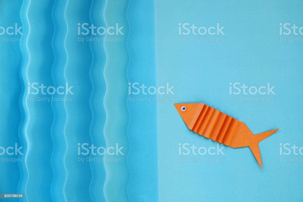 Orange tropical fish of origami stock photo