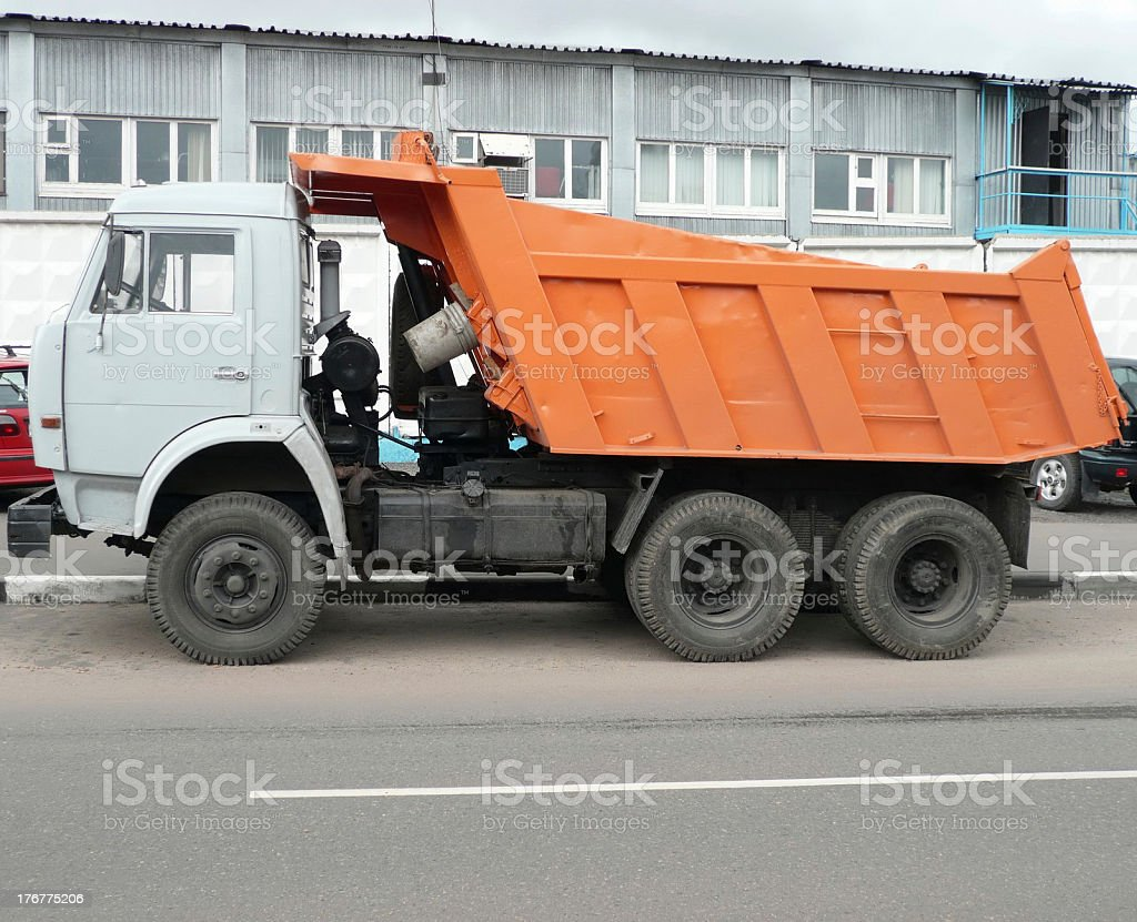 orange truck on road royalty-free stock photo