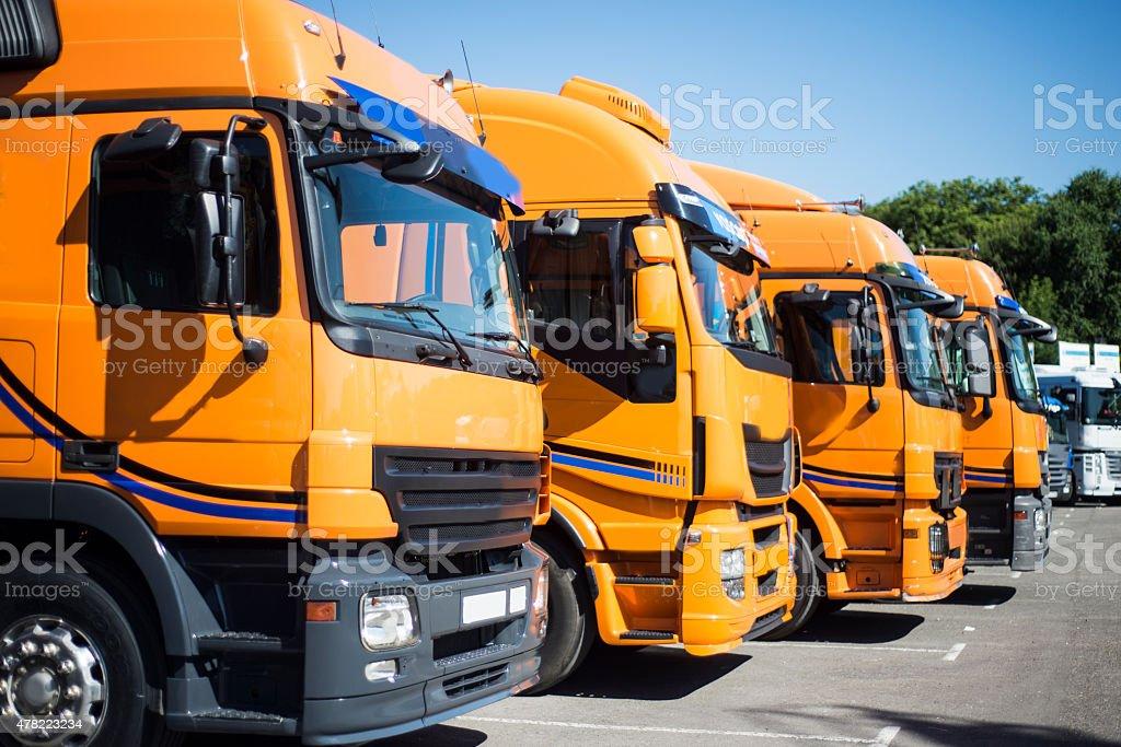 Orange trucks stock photo