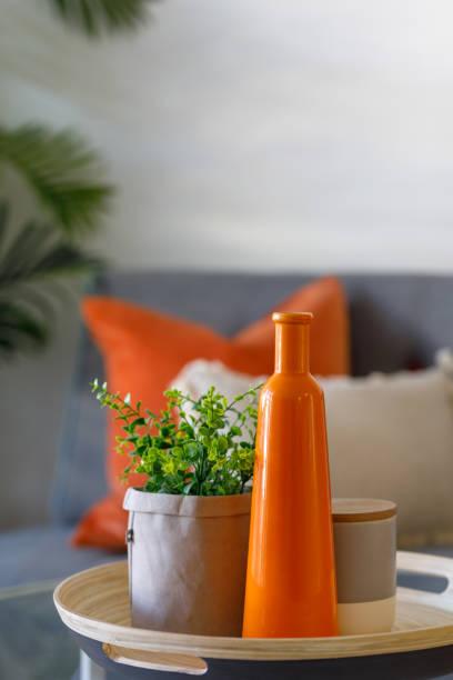 Orange Vase And Plant - Home Decor stock photo