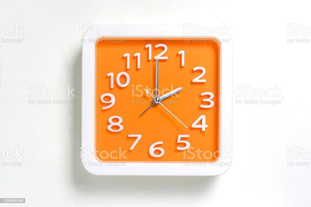 Orange Wall clock counting at 2 stock photo