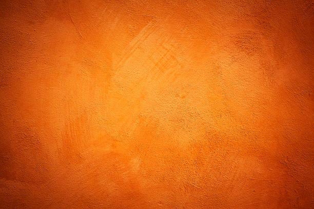 texture de mur orange - état solide photos et images de collection