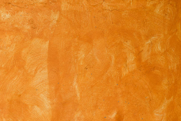 orange wall texture - mexico stock photos and pictures