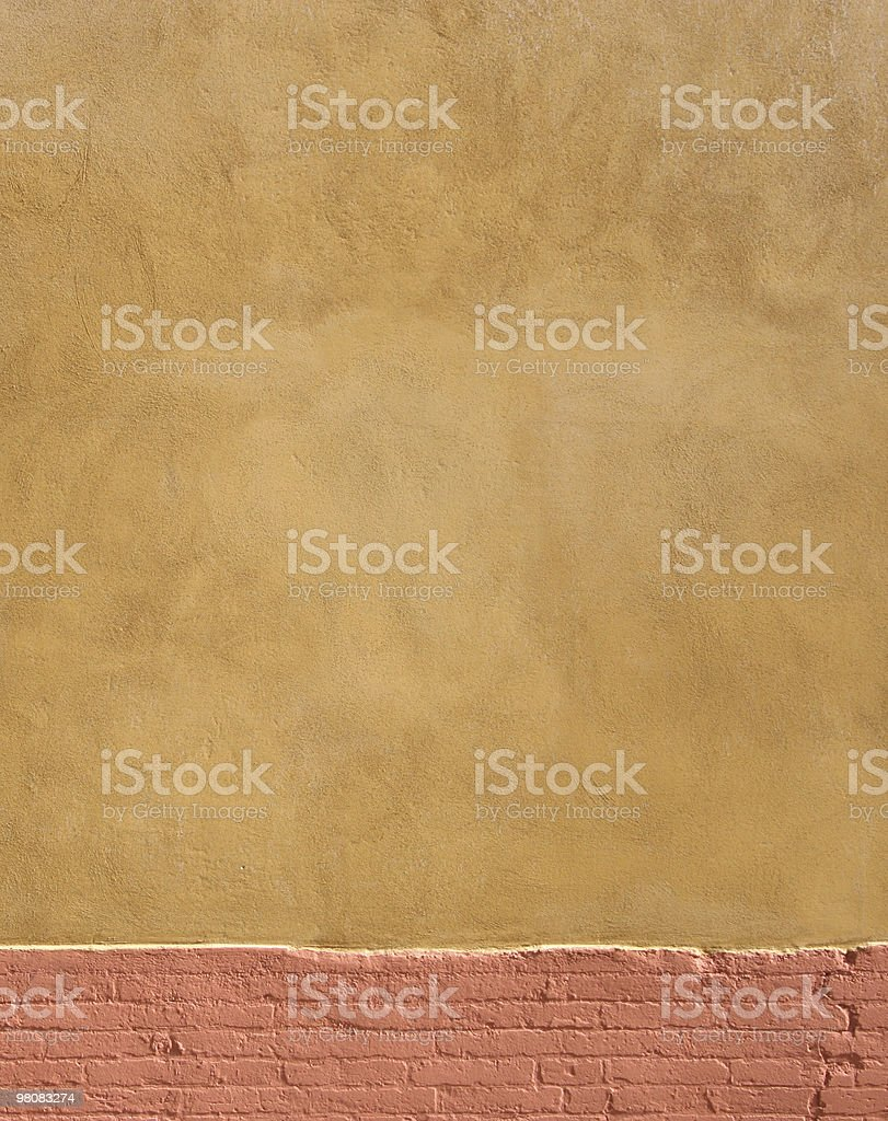 Orange wall with brick base royalty-free stock photo