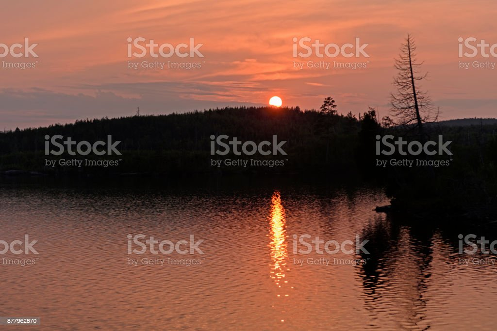 Orange Water and Skies at Sunset stock photo