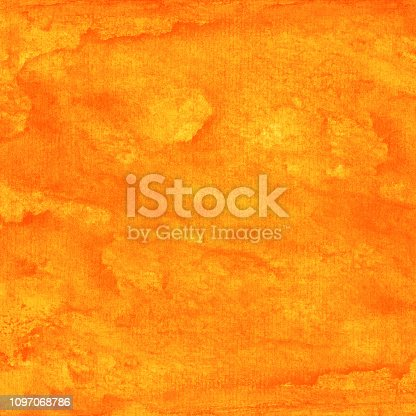 istock Orange watercolor background with texture paint and paper 1097068786