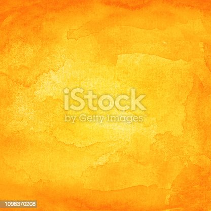 istock Orange watercolor background with texture paint and paper 1098370208