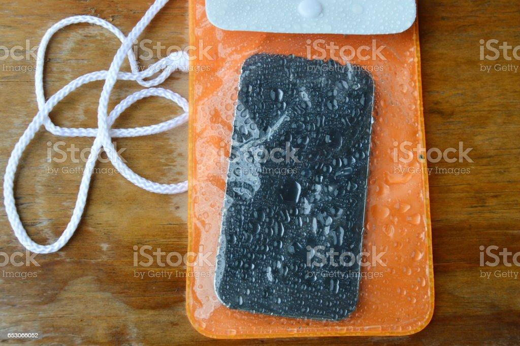 orange waterproof phone bag protection stock photo