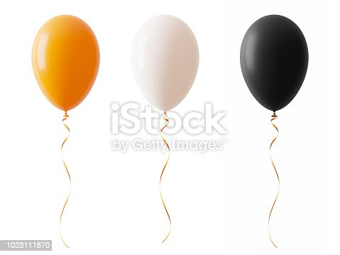 Orange white and black colored Halloween balloons isolated on white background. Horizontal composition with copy space. Clipping path is included.