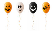 Orange White And Blacked Colored Halloween Balloons With Spooky Faces Isolated On White Background