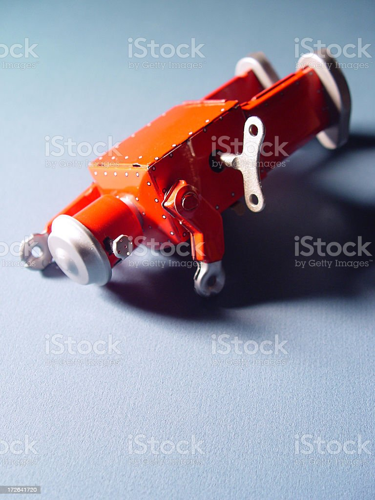 Orange wind up character out of energy stock photo