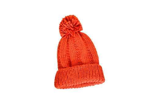 Orange wintter knitting cap on white background isolated and clippint path. Accessories for keep warm in winter season concept.