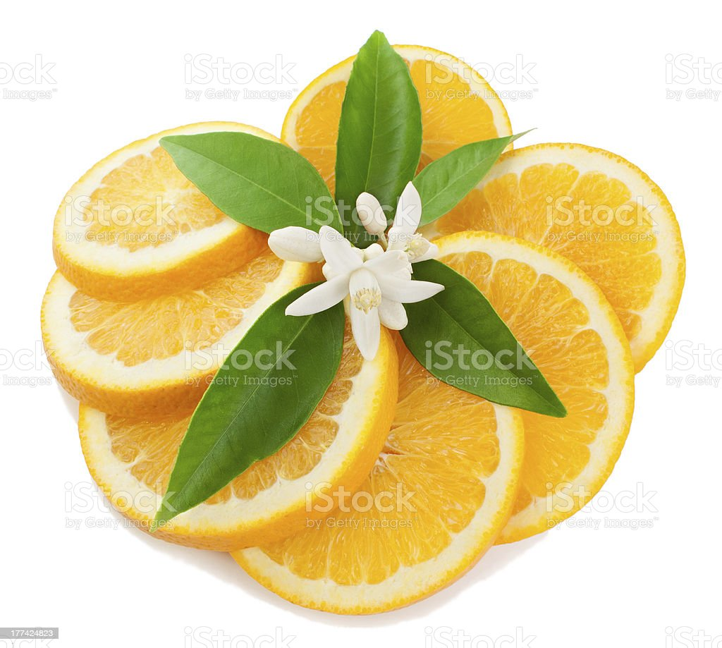 Orange with a flower and leaves royalty-free stock photo