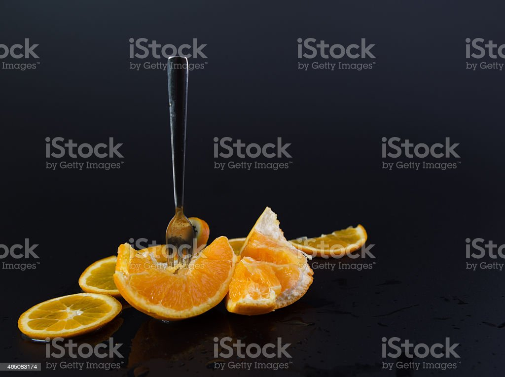 Orange with fork stabbed in it stock photo