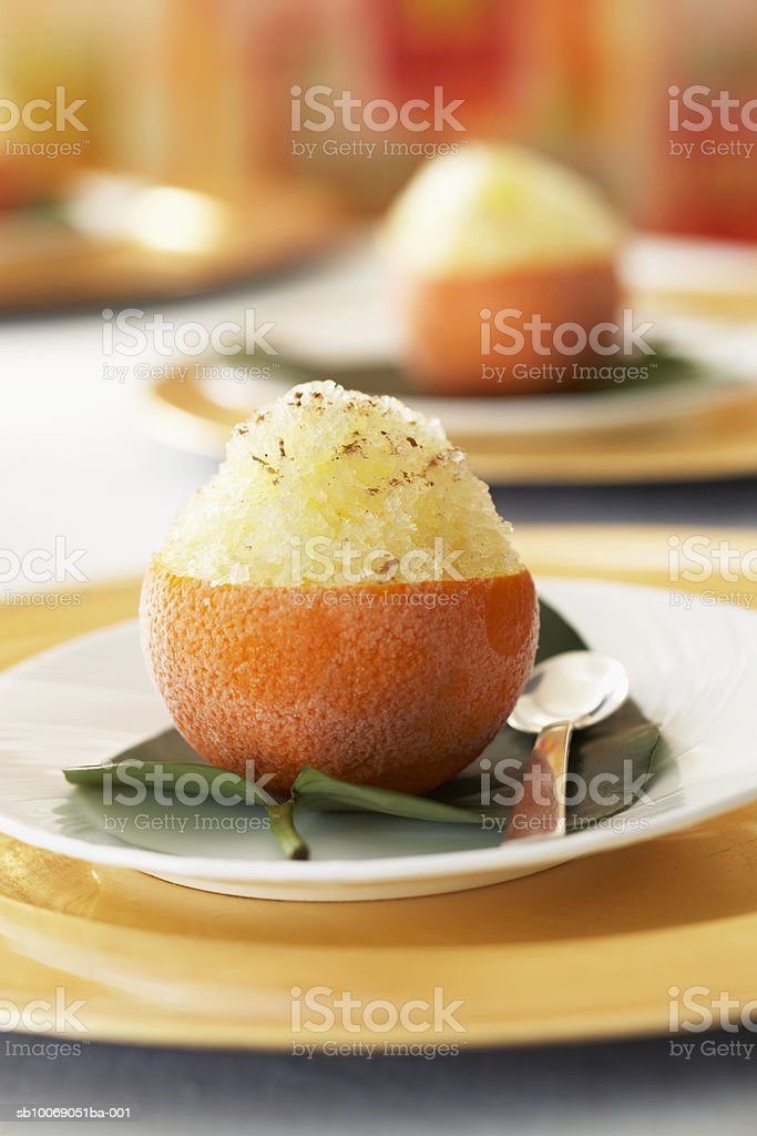 Orange with ice dessert on table, close-up foto de stock libre de derechos