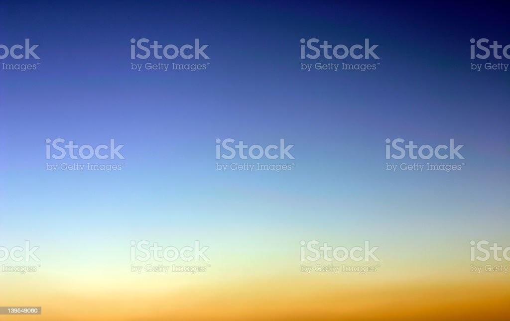 Orange, yellow, and blue image of an evening sky royalty-free stock photo