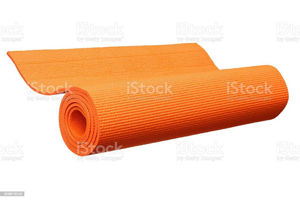 Orange yoga mat isolated on white stock photo