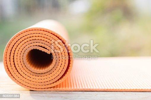 istock orange yoga mat on the garden 503391384