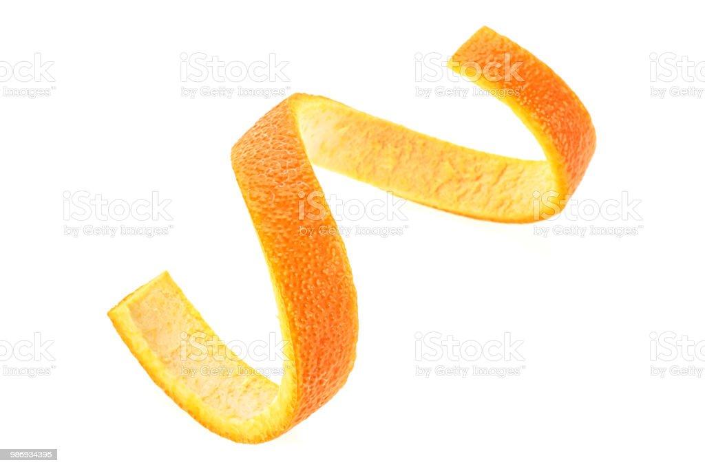 Orange zest spiral over white background. Healthy food. stock photo