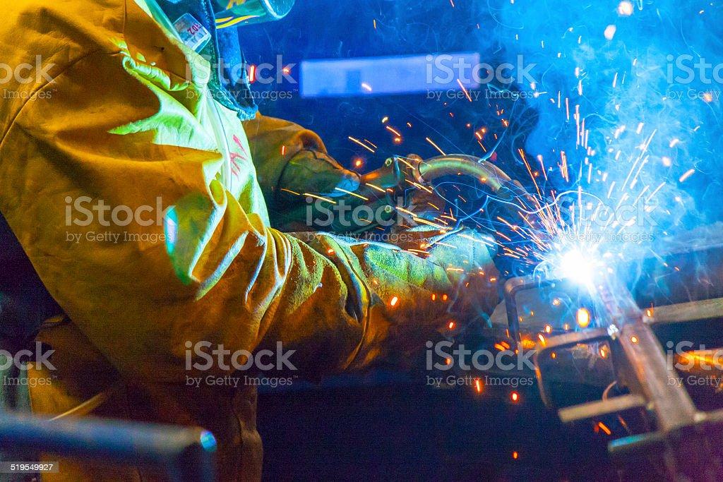 Oranger welder sparks stock photo