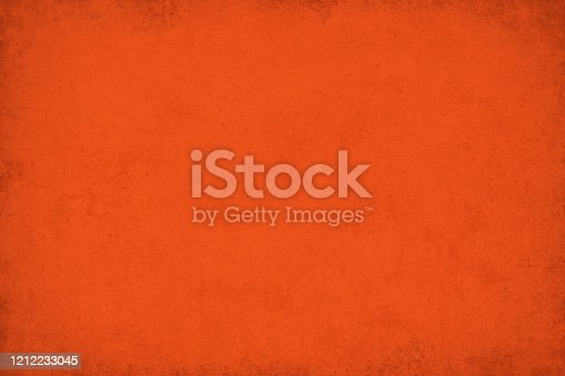 Grunge orange-red paper background. Shades of orange-red Lush lava, one of the 2020 color trends.