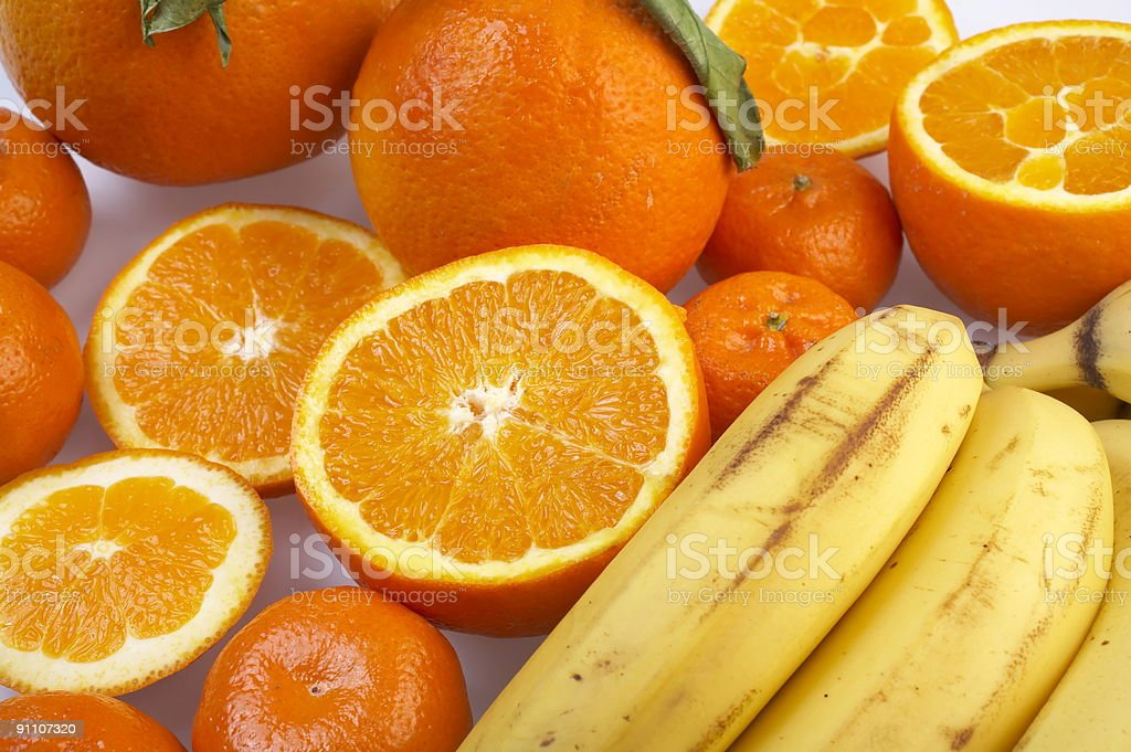 oranges and a bunch of bananas royalty-free stock photo
