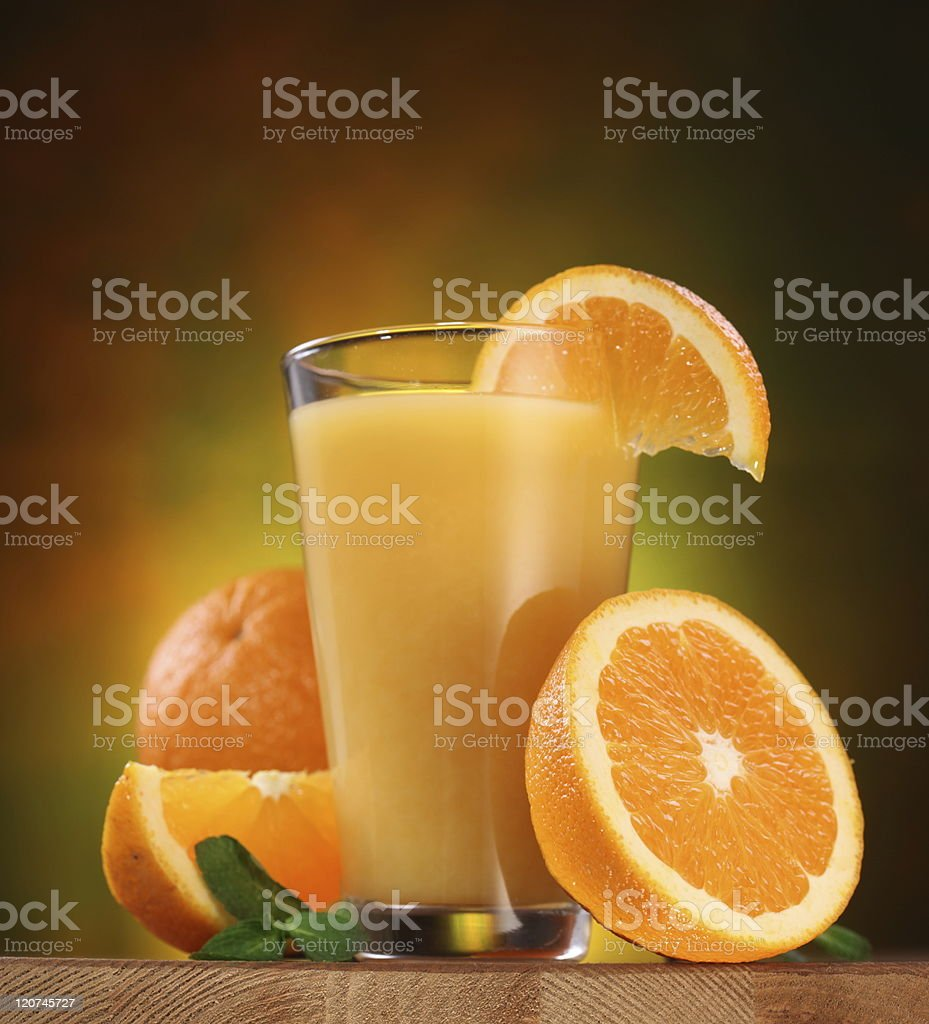Oranges and glass of juice. royalty-free stock photo